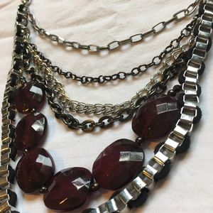 Stacked statement necklace with dark red stones